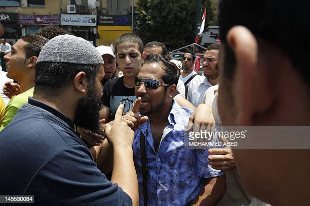 Supporter of Muslim Brotherhood candidate Mohamed Morsi argues with a man who supports the other presidential runoff candidate Ahmed Shafiq, an...