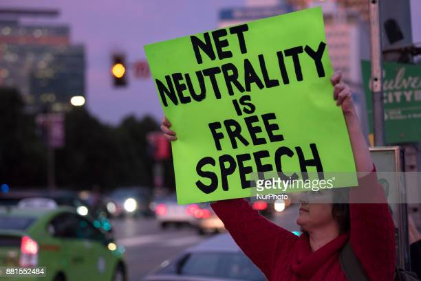 Supporter of net neutrality protests outside a Federal Building in Los Angeles California on November 28 2017 The activists gathered in protest of...
