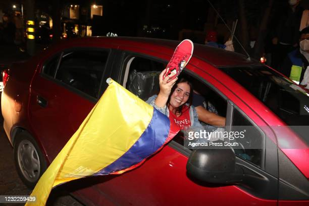 Supporter of newly elected President of Ecuador Guillermo Lasso celebrates after winning the presidential runoff against candidate of Unión Por La...