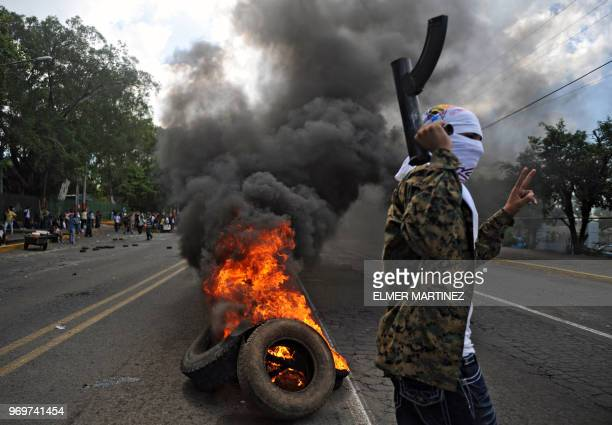 A supporter of Nicaraguan President Daniel Ortega shoots a handmade mortar launchers in a street near the US embassy during a protest in Mangua on...