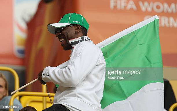 A supporter of Nigeria cheer before the FIFA Women's World Cup 2011 Group A match between Canada and Nigeria at RudolfHarbigStadion on July 5 2011 in...
