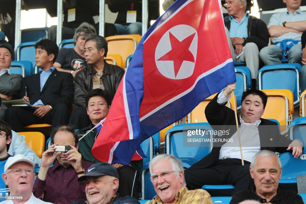 A supporter of North Korea watches a friendly football game between Greece and North Korea in Altach on May 25, 2010 ahead of their participation to the FIFA World Cup 2010 in South Africa.