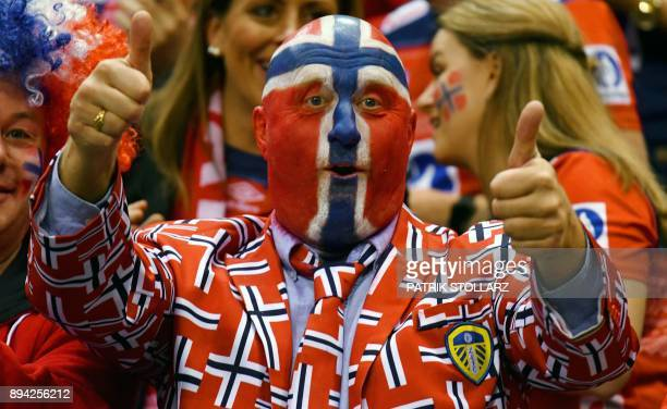 TOPSHOT A supporter of Norway cheers up his team during the IHF Womens World Championship handball final match between France and Norway on December...