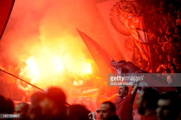 A supporter of Olympiakos Piraeus celebrates his team's victory against Siena during their Euroleague basketball game in Athens on March 30 2012...