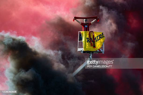Supporter of Ostersunds FK in a skylift watches the Swedish national league football match against Falkenbergs FF from outside Jamtkraft Arena in...