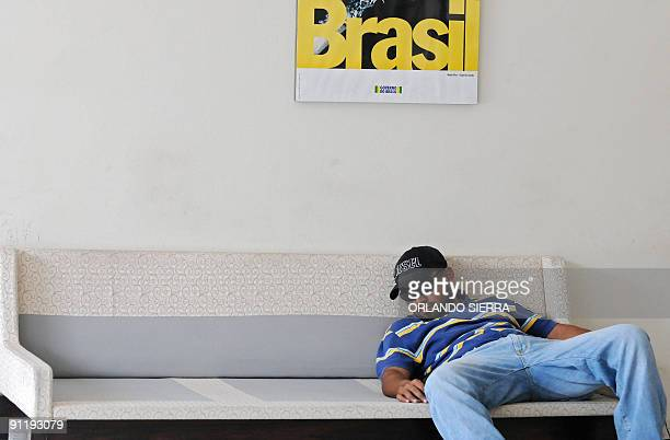 A supporter of ousted Honduran President Manuel Zelaya sleeps on a sofa at the Brazilian Embassy in Tegucigalpa on September 27 2009 Stakes rose in...