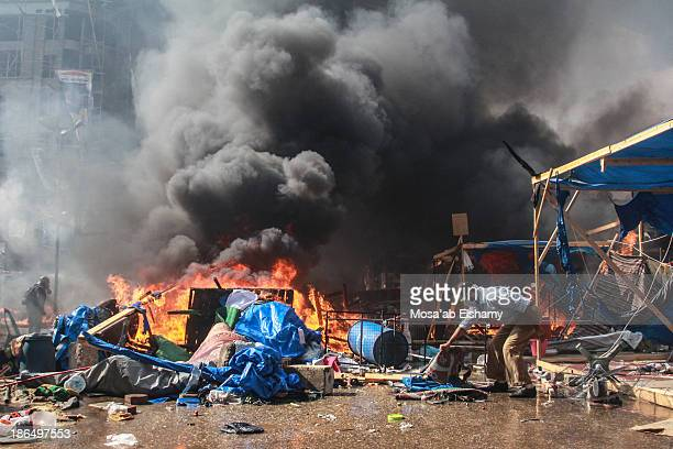 Supporter of ousted president Mohamed Morsi is seen during the clearing of Rabaa Adaweya camp by security forces, which left at least 800 killed.