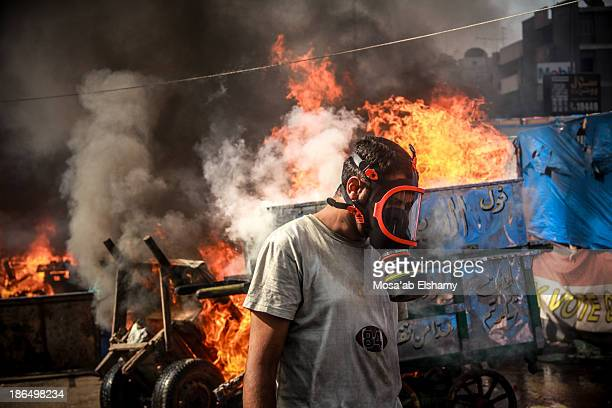 Supporter of ousted president Mohamed Morsi is seen during the violent dispersal of Rabaa Adaweya camp by security forces on August 14th, 2013. More...
