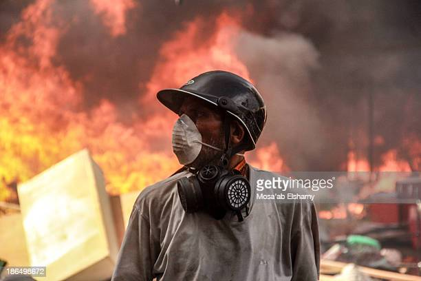 Supporter of ousted president Mohamed Morsi is seen during the violent dispersal of Rabaa Adaweya camp by security forces which left at least 800...