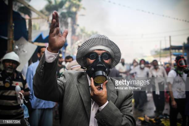 Supporter of ousted president Mohamed Morsi is seen during the clashes with police in Cairo on August 14 as security forces backed by bulldozers...