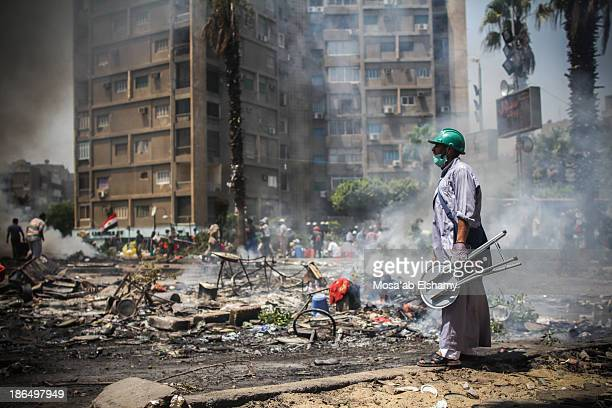 Supporter of ousted president Mohamed Morsi observes the destruction during the violent dispersal of Rabaa Adaweya camp by security forces on August...