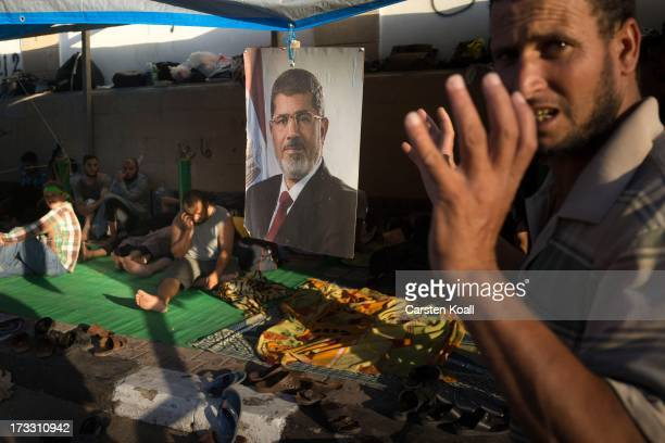 A supporter of ousted president Mohamed Morsi prays before breaking the daily Ramadan fast on the second day of Ramadan the sacred holy month for...