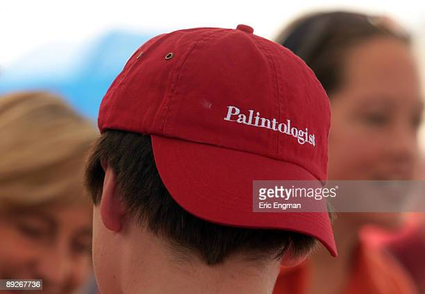 A supporter of outgoing Alaska Governor Sarah Palin wears a hat reading Palintologist during the annual Governor's Picnic July 26 2009 at Pioneer...