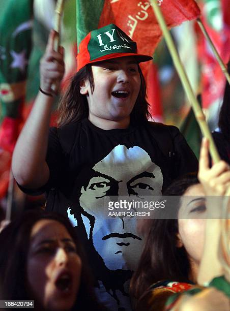 Supporter of Pakistani politician and former cricketer Imran Khan, wearing a T-shirt with a photograph of Khan, takes part in the last election...
