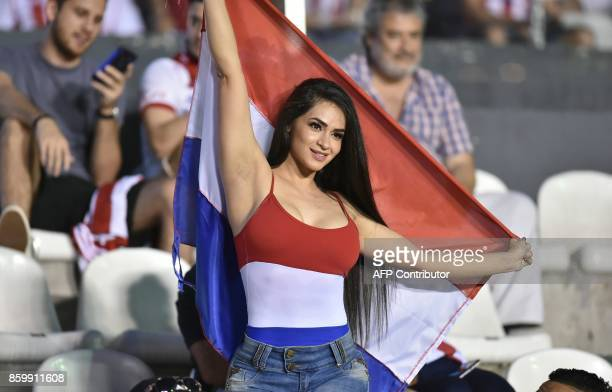 A supporter of Paraguay waits for the start of the 2018 World Cup football qualifier match against Venezuela in Asuncion on October 10 2017 / AFP...