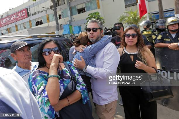 Supporter of Peruvian expresident Alan Garcia react outside the Casimiro Ulloa Emergency Hospital in Lima after learning that he died on April 17...