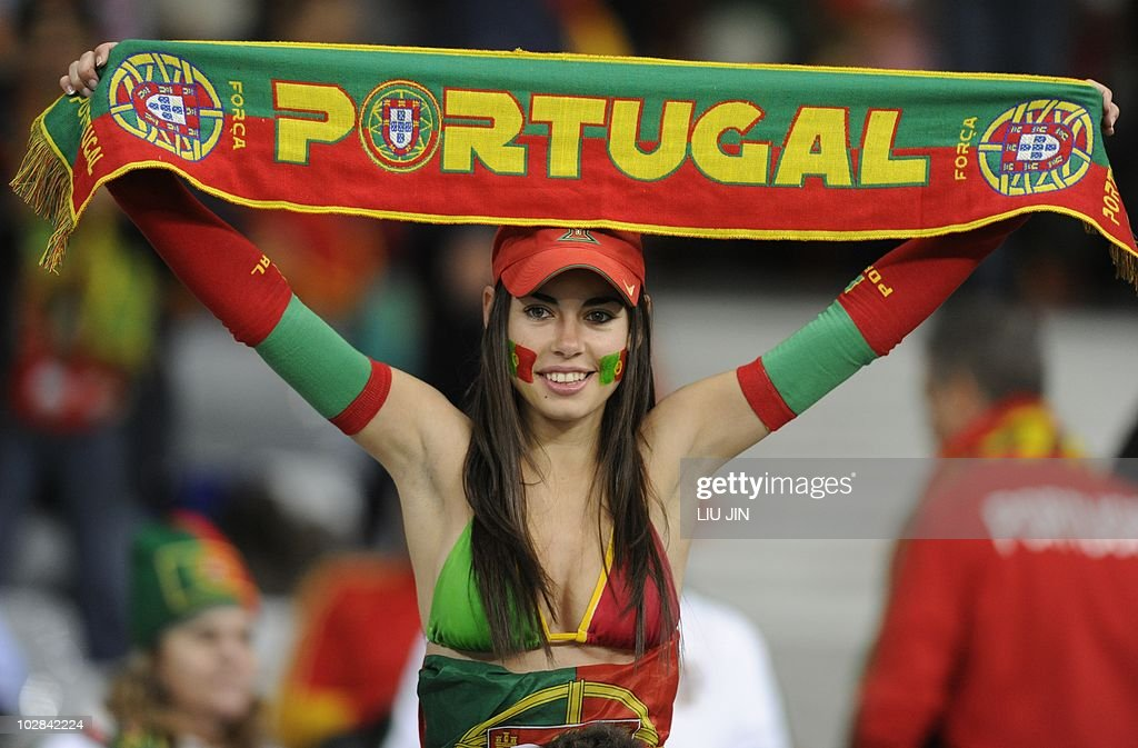 A supporter of Portugal waves the nation : News Photo