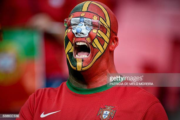 TOPSHOT A supporter of Portugal's football team sings the national anthem before the friendly football match Portugal vs Estonia at Luz stadium in...