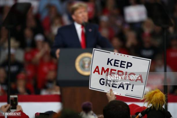 """Supporter of President Donald Trump holds up a sign at a """"Keep America Great"""" campaign rally on January 9, 2020 at the Huntington Center in Toledo,..."""