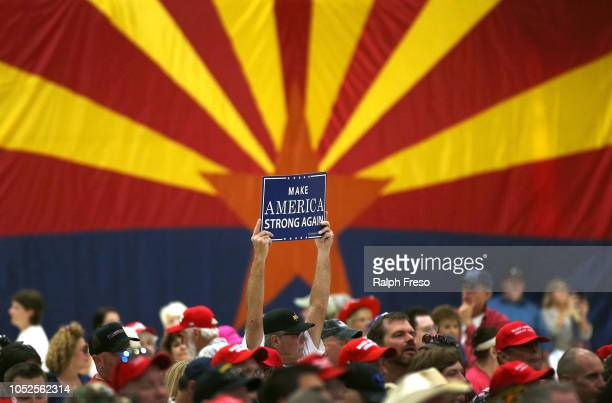 A supporter of President Donald Trump holds up a sign during the president's rally at the International Air Response facility on October 19 2018 in...