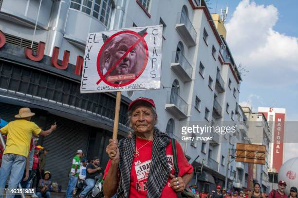 A supporter of president Nicolás Maduro holds a sign with a photo of President of United States Donald Trump crossed out during a demonstration on...