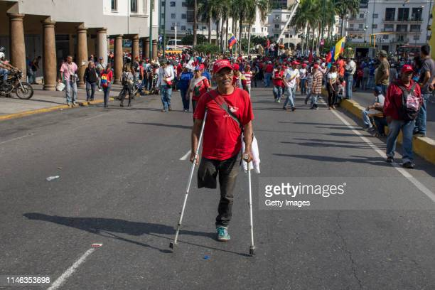 A supporter of president Nicolás Maduro with a physical disability joins a demonstration on May 01 2019 in Caracas Venezuela Yesterday Venezuelan...