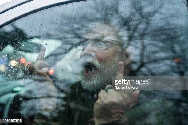 Supporter of President Trump yells at members of the media on January 6, 2021 in Salem, Oregon. Trump supporters gathered at state capitals across...