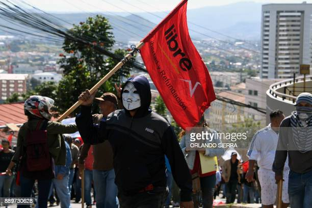 Supporter of presidential candidate for Honduras' Opposition Alliance against Dictatorship Salvador Nasralla march towards the United States embassy...