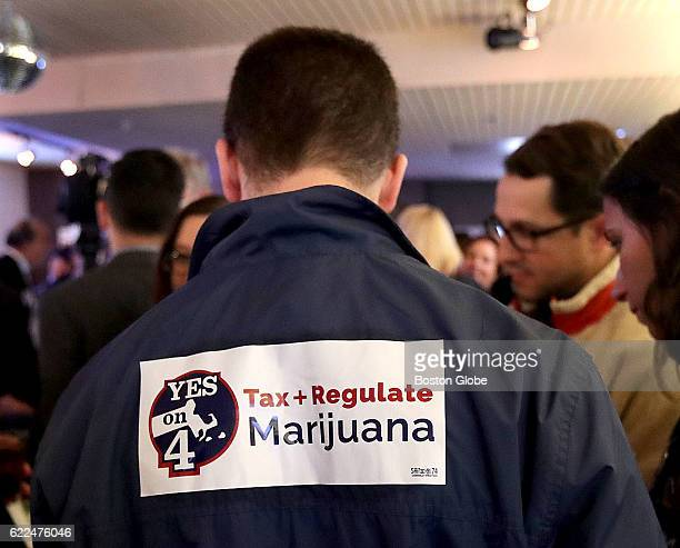 Supporter of Question Four wears the message on his jacket at the vote yes on Question Four to legalize marijuana party at Lir restaurant in Boston...