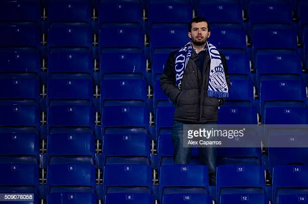 A supporter of RCD Espanyol looks dejected after the La Liga match between RCD Espanyol and Real Sociedad de Futbol at CornellaEl Prat Stadium on...