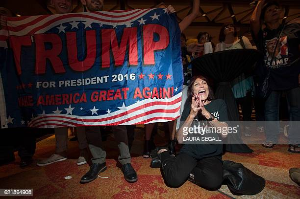 TOPSHOT Supporter of Republican candidate Donald Trump Robin Labani of Gilbert Arizona cheers as election results come in during a viewing party at a...
