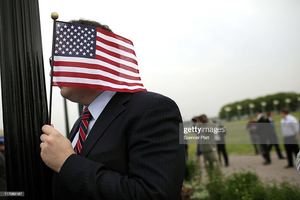 A supporter of Republican Jon Huntsman holds an American Flag as Huntsman speaks during a press conference to announce his bid for the presidency at Liberty State Park June 21, 2011 in Jersey City, New Jersey. Huntsman, until recently the U.S. ambassador to China under President Obama, emphasized his record as a two-term governor of Utah.