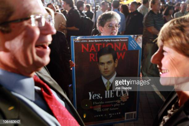 A supporter of Republican nominee for Florida US Senator Marco Rubio holds up a picture of him as she waits for him to arrive for his Reclaim America...