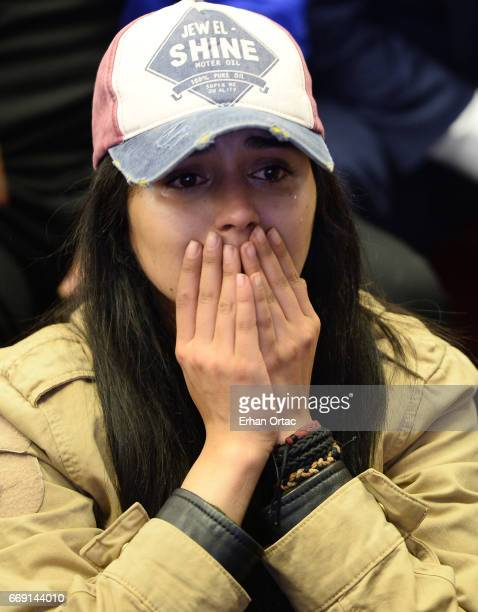 A supporter of Republican People's Party cries as she watches the polling results during a referendum in Ankara April 16 2017 Turkey Millions of...