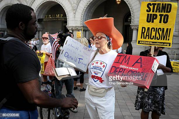 A supporter of Republican presidential candidate Donald Trump argues with protesters during a demonstration in front of the newly opened Trump...