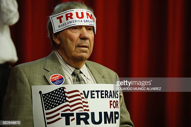 TOPSHOT A supporter of Republican presidential candidate Donald Trump attends a fundraising event in Lawrenceville New Jersey on May 19 2016 / AFP /...