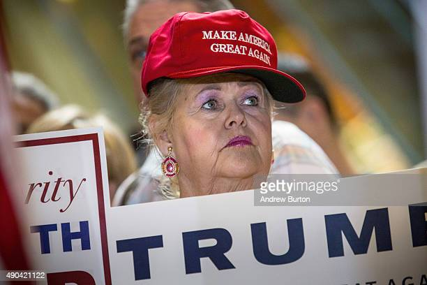 A supporter of Republican presidential candidate Donald Trump listens to Trump give a speech outlining his vision for tax reform at his skyscraper on...