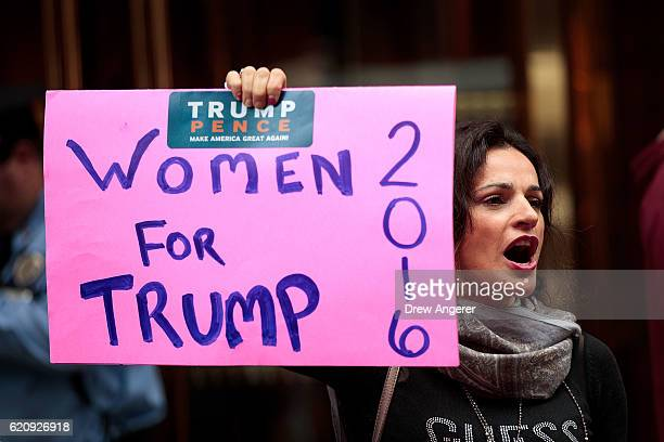 A supporter of Republican presidential candidate Donald Trump stands outside of Trump Tower November 3 2016 in New York City Election Day is less...