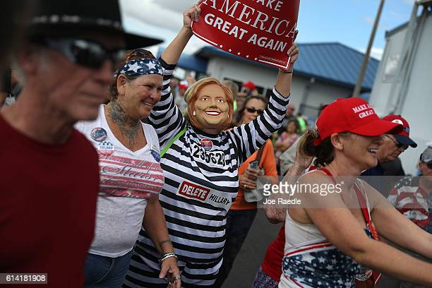 A supporter of Republican presidential candidate Donald Trump wears antiHillary Clinton prison garb as people wait for him at his campaign rally at...