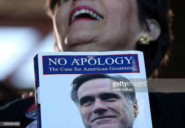 A supporter of Republican presidential candidate former Massachusetts Gov Mitt Romney holds his book 'No Apology' during campaign rally at Tampa...