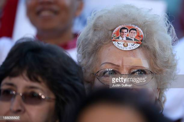 A supporter of Republican presidential candidate former Massachusetts Gov Mitt Romney wears a sticker on her forehead during campaign rally at Tampa...
