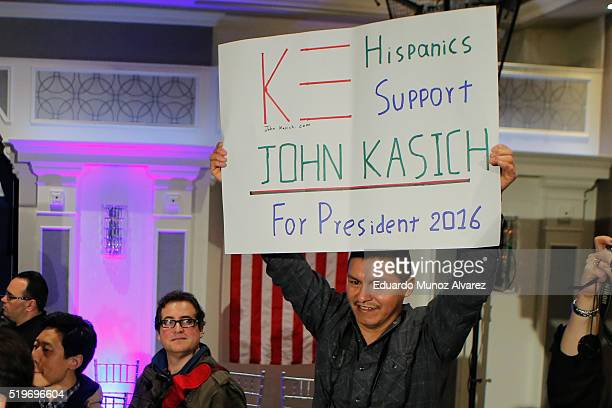 A supporter of Republican presidential candidate Governor John Kasich holds up a banner at the end of a rally on April 7 2016 in New York City Kasich...
