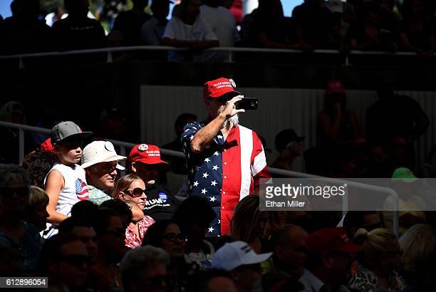 A supporter of Republican presidential nominee Donald Trump records images on his cell phone during a campaign rally at the Henderson Pavilion on...