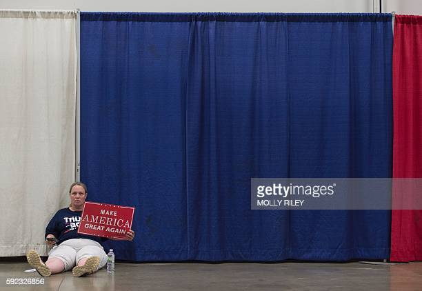A supporter of Republican presidential nominee Donald Trump waits for a Trump rally to start at Fredericksburg Expo Center August 20 2016 in...
