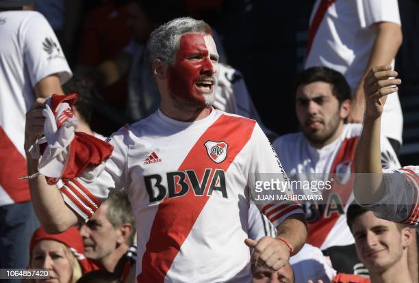 A supporter of River Plate cheers at the Monumental stadium in Buenos Aires on November 24 2018 while authorities decide if the second leg match of...