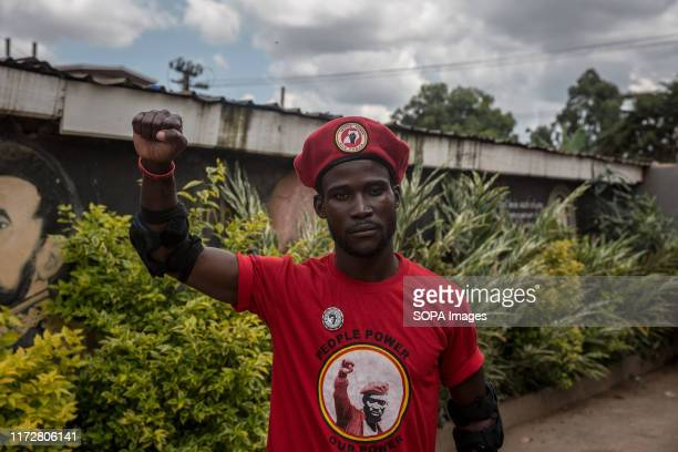A supporter of Robert Kyagulanyi aka Bobi Wine makes a gesture during the press conference in Kampala Uganda's military announced that red berets had...