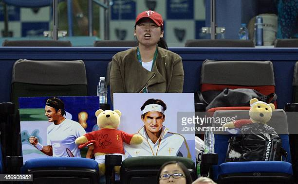 A supporter of Roger Federer of Switzerland cheers during the men's singles third round match Federer and Spain's Roberto Bautista Agut at the...