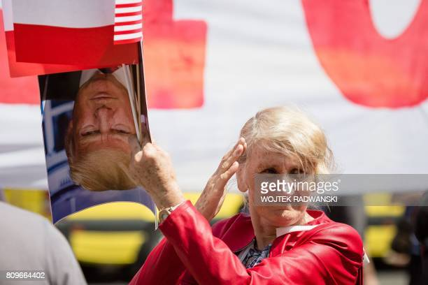 A supporter of ruling Law and Justice party is seen greating US President Donald Trump during his visit in Warsaw Poland on July 6 2017 Donald Trump...
