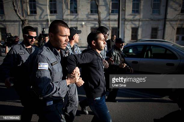 A supporter of Samer alIssawi a Palestinian prisoner who is on a hunger strike is arrested by Israeli police during clashes following a demonstration...