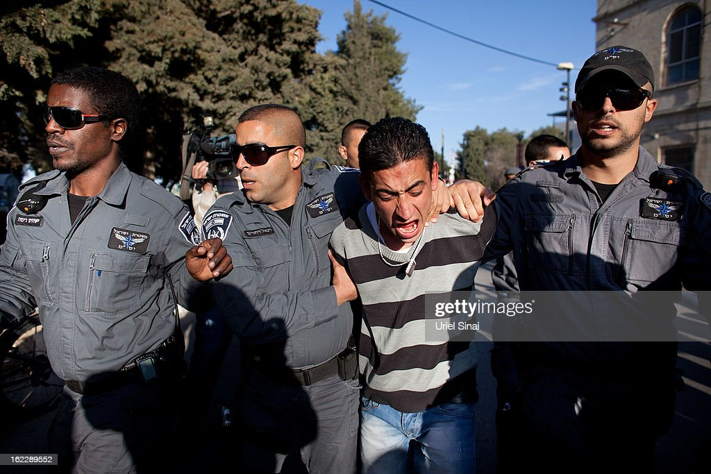 A supporter of Samer al-Issawi, a Palestinian prisoner who is on a hunger strike, is arrested by Israeli police during clashes following a demonstration outside the Magistrate's Court on February 21, 2013 in Jerusalem, Israel. Issawi, one of the prisoners who was released under terms of the 2011 Gilad Shalit prisoner swap, was rearrested last July on charges of violating the terms of his release when he took his car to a garage in the West Bank.
